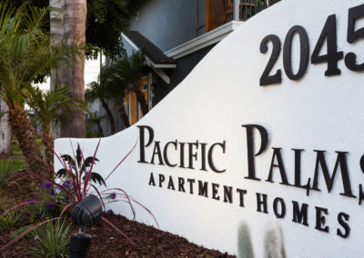 sign monument of 2045 pacific palms apartment homes